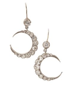 A pair of late Victorian diamond set crescent earrings, each collet set with an old cut diamond suspending a graduated old cut diamond set crescent, set in silver.