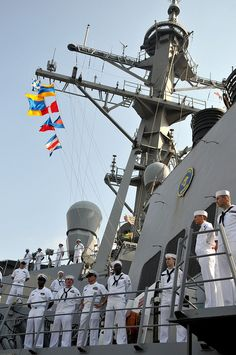 Sailors man the rails of USS Decatur as ship pulls into Chennai, India.