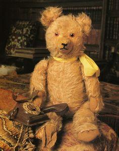 stuffed teddy bear with a phone