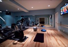Traditional Home Gym with Standard height, French doors, Paint, can lights, specialty door, Hardwood floors, Exposed beam