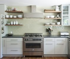 Cabinet pulls  clean subway tile    Modern U-shaped Teal kitchen, light blue cabinets, $50,000 - $100,000, Hello Kitchen, Austin