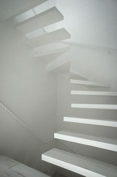 Ghosted white floating stairs | unknown designer |