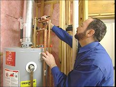 HOW TO UPGRADE A WATER HEATER - Learn how to upgrade a water heater and install a damming system to catch the water without having to drain the tank.
