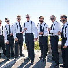 Real Weddings - Eric and his groomsmen wore matching James Bond tuxedos with black slacks and white jackets. The groom stood apart from his groomsmen slightly by wearing a bow tie, as opposed to the long black ties of his groomsmen.  - See more at: http://inblissweddings.com/real-weddings/story/brandy_and_eric/232#sthash.81aF9Sr5.dpuf  Image Credit: Stevi Sayler Photography  In Bliss Weddings