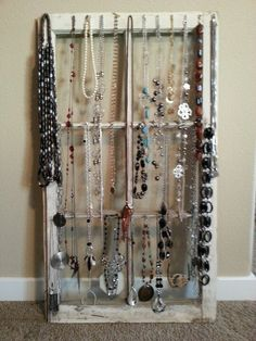 Necklace display using an old window... Genius!!