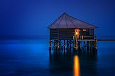 Long exposure photograph of a water villa in The Maldives. Komandoo is a small, quiet resort island in the Lhaviyani Atoll of the Maldives Twilight Photos, Water Villa, Around The World In 80 Days, Most Beautiful Beaches, Nature Images, Adventure Awaits, Landscape Photographers, Maldives, Beautiful Landscapes