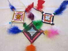 Weaving-god's eyes, have some tied together and started for kids to finish
