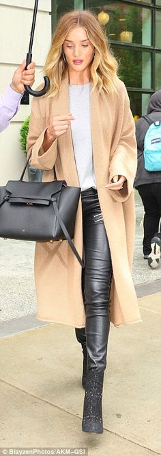 Wow thing: She teamed the number with a pair of form-fitting leather trousers which showed off her long and lean legs