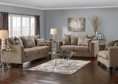 Create a modern and comfortable living room or family room with the contemporary Newcastle Collection in platinum. The collection features plush woven polyester fabric, loose toss pillows and brushed nickel nailhead accents throughout the arms and base of the pieces. Includes sofa, loveseat and chair. ***Cocktail ottoman sold separately.