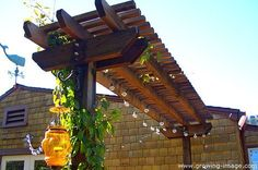 The wooden pergola is a good solution to add beauty to your garden. If you are not ready to spend thousands of dollars for building a cozy pergola then you may devise new strategies of trying out something different so that you can re Diy Pergola, Veranda Pergola, Front Porch Pergola, House Front Porch, Small Pergola, Pergola Attached To House, Pergola Swing, Pergola With Roof, Cheap Pergola