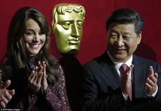 The Duchess of Cambridge and Mr Xi were photographed at a BAFTA presentation at the event ...