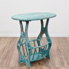 This shabby chic end table is featured in a solid wood with a distressed light blue and white chalk paint finish. This side table is in good condition with an oval table top, carved curved sides and a bottom magazine rack tier. Great for storing magazines and sewing supplies! #shabbychic #tables #endtable #sandiegovintage #vintagefurniture