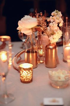 If copper centerpieces are hard to find - dip dye glass with some copper paint. That might be pretty with a mix of clear, green, and blue glasses?
