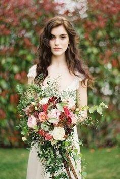 For fall weddings, deep and rich autumnal tones work especially well in larger arrangements. Blending these with trailing greenery finishes the piece.