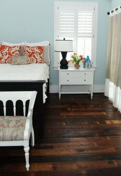 The pale blue walls with the dark wood floor and black bed! Dave Probyn I WANT when we get married!!!!