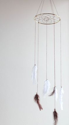 29. #Dreamcatcher - 29 DIY Mobile #Projects for Nimble #Fingers ... → DIY [ more at http://diy.allwomenstalk.com ]  #Stringyarn #Swarming #Theme #Country #Elephants