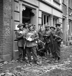 Infantrymen of The Queen's Own Cameron Highlanders of Canada examining a quantity of German Reichsmarks left behind by fleeing civilians, Xanten, Germany, 9 March Then image: LAC DND 47621 No… Canadian Soldiers, Canadian Army, Canadian History, British Soldier, British Army, Royal Canadian Navy, War Image, Korean War, History Photos