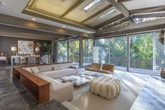 Sunken living room with backed bookcases and skylight ceiling