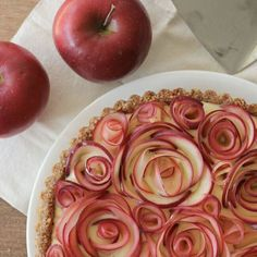 Apple Rose Tart with Maple Custard and Walnut Crust (Gluten Free) Apple Rose Pie - beautiful! This looks frustratingly difficult, but I want to try making it. Apple Rose Tart, Apple Roses, Apple Flowers, Delicious Desserts, Dessert Recipes, Yummy Food, Custard Desserts, Apple Recipes, Sweet Recipes