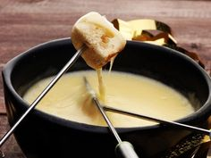 Slow Cooker Fontina And Gruyere Cheese Fondue - Don't miss out on the magic (and romance) of fondue just because you don't have a fondue pot. A good old crockpot works like a charm for making this melty mixture of Fontina and Gruyere. Crock Pot Cheese Fondue Recipe, Fondue Recipes, Cheese Recipes, Cooking Recipes, Fondue Cheese, Cooking Ideas, Crockpot Veggies, Cheese Sauce For Pasta, Fontina Cheese