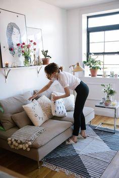 White walls, window shelf, green leafy plants, neutrals