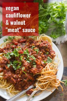 """Cauliflower and walnut crumbles are seasoned, baked and smothered in zesty tomato sauce to make this vegan version of spaghetti bolognese. You'll love this vegetarian """"meat"""" sauce! Easy enough for a weeknight pasta dinner and packed with flavor! #veganrecipes #vegandinner #healthyrecipes #pasta"""