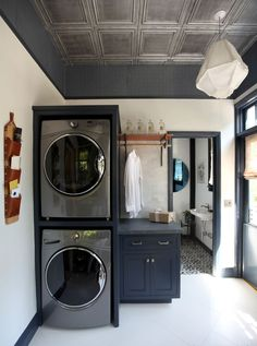 """""""The washer and dryer units are very deep, so I chose to stack them in the deepest corner of the room,"""" says Triano. """"This saved floor space and allowed me turn an ordinary laundry room into a space with multiple functions, or a 'family command center' as I like to call it."""" 