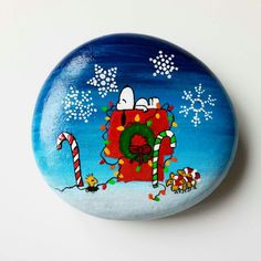 snoopy and woodstock christmas painted rock