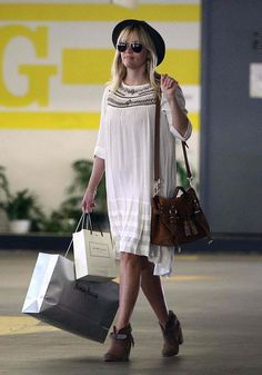 REESE WITHERSPOON spotted out and about doing a little shopping in Beverly Hills. She wore a white dress with a pair of super cute Rag & Bone Harrow leather ankle boots and toting  Mulberry Tassel Heavy Suede Satchel bag   *courtesy of Delortae Agency UK's 1st luxury authentic handbag SPA Visit us on Facebook: http://www.facebook.com/DelortaeAgency