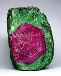 Todays #MineralOfTheDay is Ruby Zoisite. Red Ruby is usually spread irregularly throughout the Green zoisite. what do you think? Geology Wonders