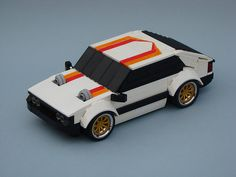We're not fans of Eastern Europe's communist automotive efforts. But if there's proof that forced induction, wide arches, and racing stripes can make anything cool, this is it. Lego Cars Instructions, Lego Machines, Turbo Car, Micro Lego, Lego Pictures, Lego Mecha, Vintage Lego, Lego Design, Lego Models
