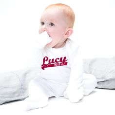The perfect personalised baby grow for trendy tots and super sporty babies, a great gift idea for a newborn baby.