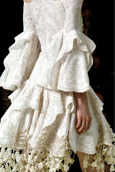 Alexander McQueen...Wow beautiful details to recreate. Pick 1-3 details that fit your wedding theme. Get that designer look without the designer $$$, have it custom-made.