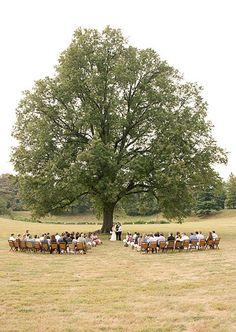 fall farm wedding - ceremony under the tree on hay bails
