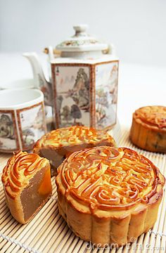 Photo about Traditional Mooncake on a mat with tea pot as background. Image of reunion, cuisine, sweet - 20868958 Cute Food, Good Food, Yummy Food, Tasty, Japanese Food Names, Chinese Moon Cake, Mooncake Recipe, Cake Festival, Bean Cakes