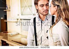 Portrait of a handsome fashionable man with  charming woman posing in the interior. - stock photo