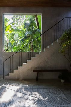 High ceiling space with concrete stairs beside a large fixed window. In the project Thong House in Ho Chi Minh, Vietnam, designed by NISHIZAWAARCHITECTS. Photographed by Decon Photo Studio. Architecture Details, Interior Architecture, Exterior Design, Interior And Exterior, Estilo Tropical, Stair Handrail, Railings, Concrete Stairs, Exterior Stairs