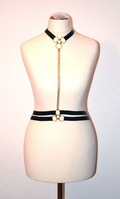 Black lacquer leather harness with golden rings and golden chain https://kivaleatheraccessories.wordpress.com/2015/01/19/glamorous-harnesses/