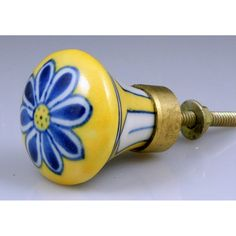 Hand-painted  Blue and Yellow Pottery Ceramic Knob with Brass Details.    Size: 1.5″ h x 1.5″ w x 1.75″ d Sold in multiples of 2