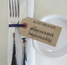 Sure, no one is going to notice if you don't have napkin rings at your dinner place settings but we can bet guests will be totally tickled to see these thoughtfully done musical note napkin rings. The kraft paper gives them a rustic feel so they'd be a great way to elevate the tablescape at your barn wedding.
