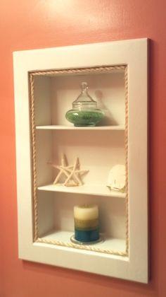 turned old medicine cabinet into display shelves