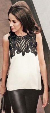Elegante blusa sin mangas con detalle de encaje en la zona del cuello de kaleidoskopic.