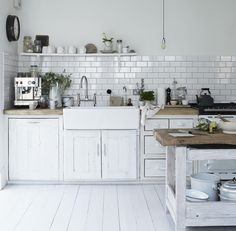 pretty much everything i want in a kitchen! white kitchen bare bulbs subway tiles white floor boards rustic bench tops the tapware the black french school clock!----ugliest kitchen ever idk how this could b a dream kitchen. All White Kitchen, New Kitchen, Kitchen Dining, Kitchen Decor, Kitchen Tiles, Kitchen Shelves, Kitchen Island, Vintage Kitchen, Minimal Kitchen