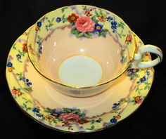 Doris shape tea cup and saucer. Saucer is about 5 across. Tea cup measures about 3 by about 2 high. Peachy pink on the inner cup with cream border. Tea Cup Set, My Cup Of Tea, Tea Cup Saucer, Yellow Cups, Teapots And Cups, China Tea Cups, Tea Service, Mellow Yellow, Drinking Tea