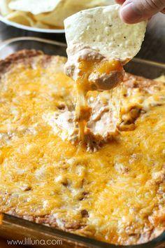 Our new favorite dip - Cream Cheese Bean Dip! SOO good! { lilluna.com } Recipe includes sour cream, cream cheese, Mexican cheese, refried beans, and salsa.