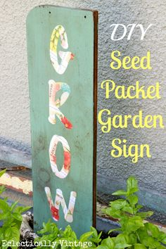 DIY Seed Packet Garden Sign - simple and a great welcome to any garden!  eclecticallyvintage.com