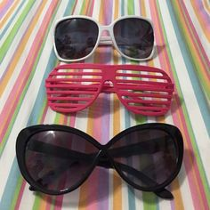 Sunglasses bundle 3 glasses. 1 black vintage inspired sunglasses, 1 big white sunglasses, 1 pink party glasses.            FREE gift with every purchase. When you purchase pick a number 1-3, write it in a comment, and this will determine which bag I draw your gift from! Accessories Sunglasses