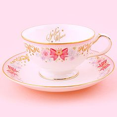 This beautiful and unique bone china tea cup and saucer set is the glorious result of a collaboration between Bandai Sailor Moon Anniversary and Noritake. Premium Bandai says that the design is inspired by the romance between Sailor Moon and Tuxedo Mask. Tea Cup Saucer, Tea Cups, Arte Sailor Moon, Sailor Moon Party, Sakura Card Captors, Sailor Moon Collectibles, Sailor Moon Merchandise, Sailor Moon Aesthetic, Moon Princess
