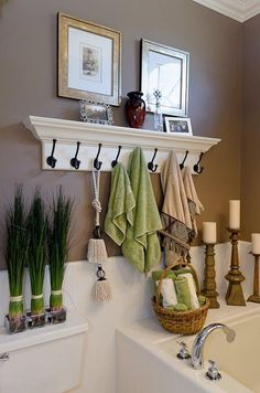 Master Bathroom....like this concept. Maybe a shelf with fewer hooks and then you put your different bath salts in beautiful jars, and some candles, and possibly a picture of your loved one on top of the shelf. And, then I would hang a small mirror above it to reflect the candle light!