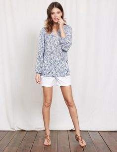 Our bestselling Dolly Top returns in two new striking prints. Flattering features include the drapey viscose fabric, gathered elasticated cuff, a notch neck and feminine blouson sleeves. Tuck into pencil skirts. Slip on with jeans. Throw over leggings. Day or night, this blouse is just as skilled at multi-tasking as you are (well, almost).